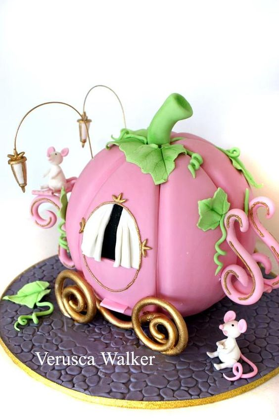 pink color cake in the shape of a pumpkin with a fondant mouse