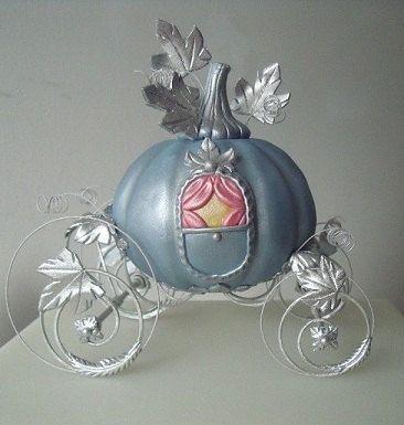 blue color pumpkin made with wheels by fairy godmother