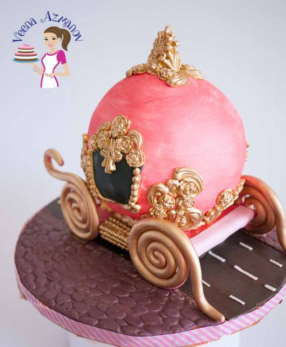 a beautiful carriage cake made with gold fondant and pink fondant